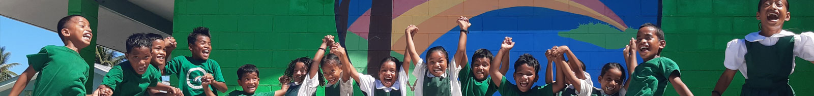 children holding hands and jumping in the air